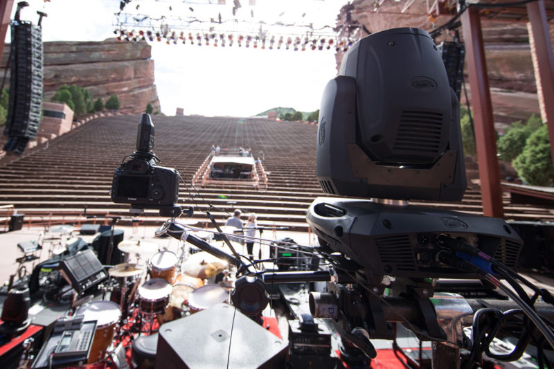 Canon 5D Mark III with 14mm f/2.8 lens and PocketWizard Plus III set up on a Manfrotto variable friction Magic Arm as a remote camera on a Manfrotto variable friction Magic Arm behind Third Day's drum kit on June 14, 2015 at Red Rocks Amphitheater in Morrison, Colorado