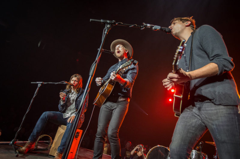 Seth Bolt, Bear Rinehart, and Bo Rinehart of Needtobreathe perform during the Third Day and Friends concert at Infinite Energy Center in Atlanta, Georgia