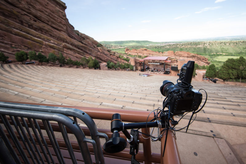 Canon 5D Mark III with 8-15mm fisheye lens and PocketWizard Plus III set up as a remote camera on a Manfrotto variable friction Magic Arm at the back corner of Red Rocks Amphitheater in Morrison, Colorado
