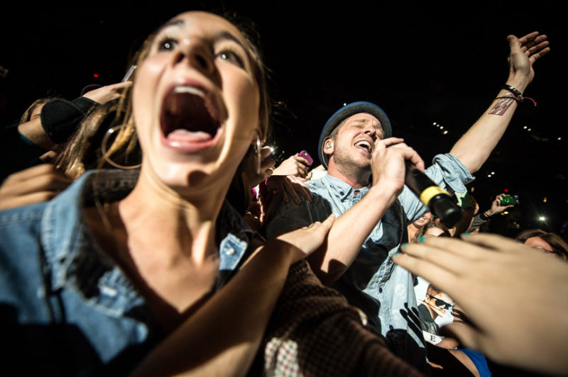 Ryan Tedder of OneRepublic sings to fans in the crowd during 93.3 FLZ's Jingle Ball in Tampa, Florida