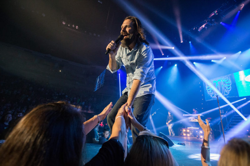 Mac Powell of Third Day greets fans during the Third Day and Friends concert at Infinite Energy Center in Atlanta, Georgia