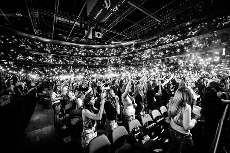 Fans light up the arena as Ed Sheeran performs during 93.3 FLZ's Jingle Ball in Tampa, Florida