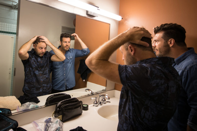 David Carr and Scotty Wilbanks of Third Day get ready backstage on June 14, 2015 at Red Rocks Amphitheater in Morrison, Colorado
