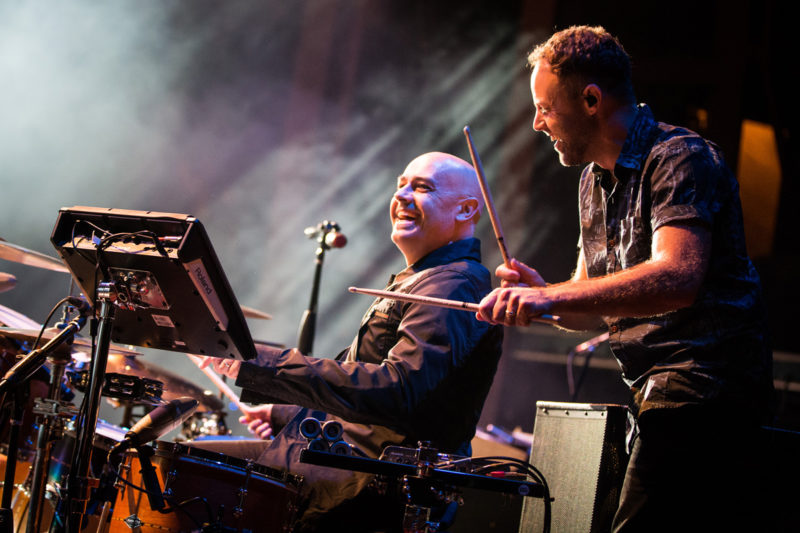 Peter Furler plays drums as David Carr of Third Day watches on June 14, 2015 at Red Rocks Amphitheater in Morrison, Colorado