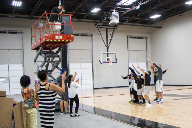 Brad Moore photographs Dude Perfect on the basketball court at their headquarters in Frisco, Texas