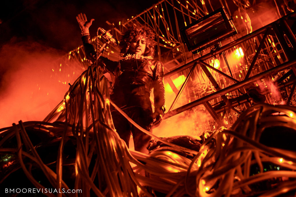 Wayne Coyne of The Flaming Lips performs in an onslaught of red light at Gasparilla Music Festival in Tampa, Florida