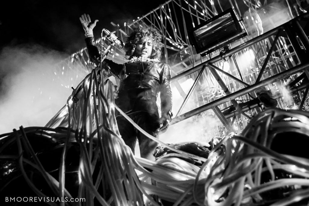 Black and white photo of Wayne Coyne of The Flaming Lips performing during Gasparilla Music Festival in Tampa, Florida