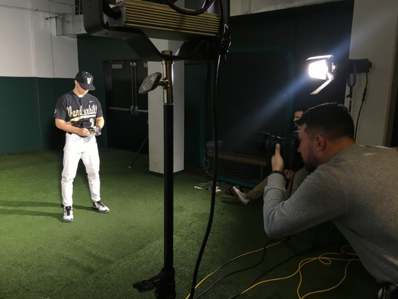 Rob Foldy photographs a Vanderbilt University baseball player for ESPN Network