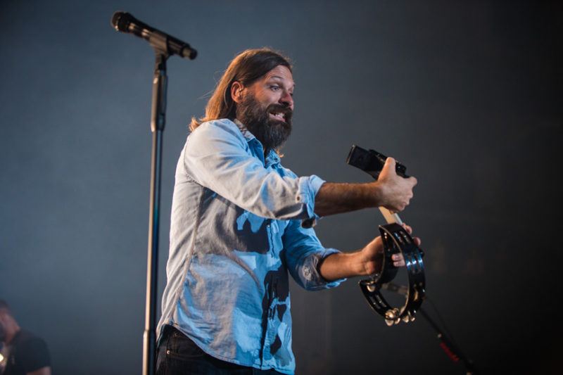 Mac Powell of Third Day grabs a fan's camera during the Third Day and Friends concert at Infinite Energy Center in Atlanta, Georgia