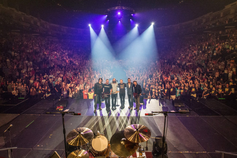 Brian Bunn, Tai Anderson, Mac Powell, David Carr, Scotty Wilbanks, and Mark Lee of Third Day pose with the sold out crowd at Infinite Energy Center in Atlanta at the end of the show