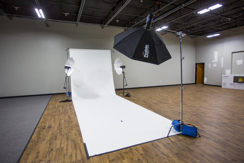 Seamless paper background and studio lights set up for Dude Perfect photo shoot