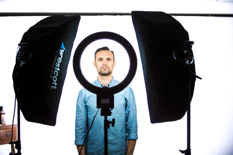 Photo showing ring light and strip bank constant light setup for portraits