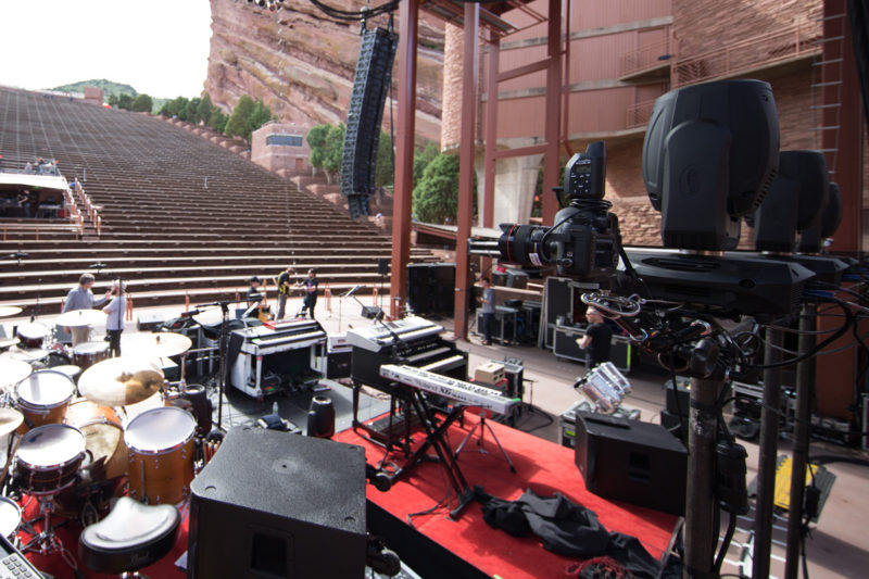 Canon 5D Mark III with 14mm f/2.8 lens and PocketWizard Plus III set up as a remote camera on a Manfrotto variable friction Magic Arm behind Third Day's drum kit on June 14, 2015 at Red Rocks Amphitheater in Morrison, Colorado